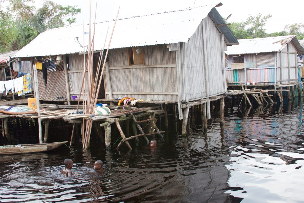 The village built on stilts - children enjoying the relatively clean water